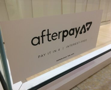 afterpay advertisement on shop window