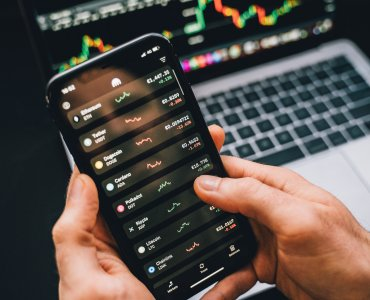 bitcoin exchange wallet prices app on phone and laptop