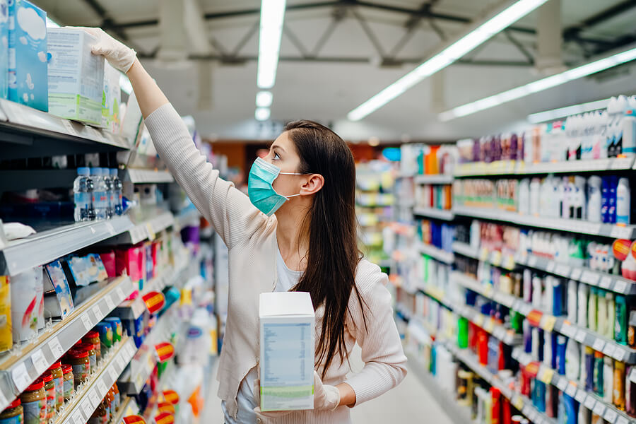 Woman Wearing Mask And Gloves Buying Baby Formula Due To Covid19