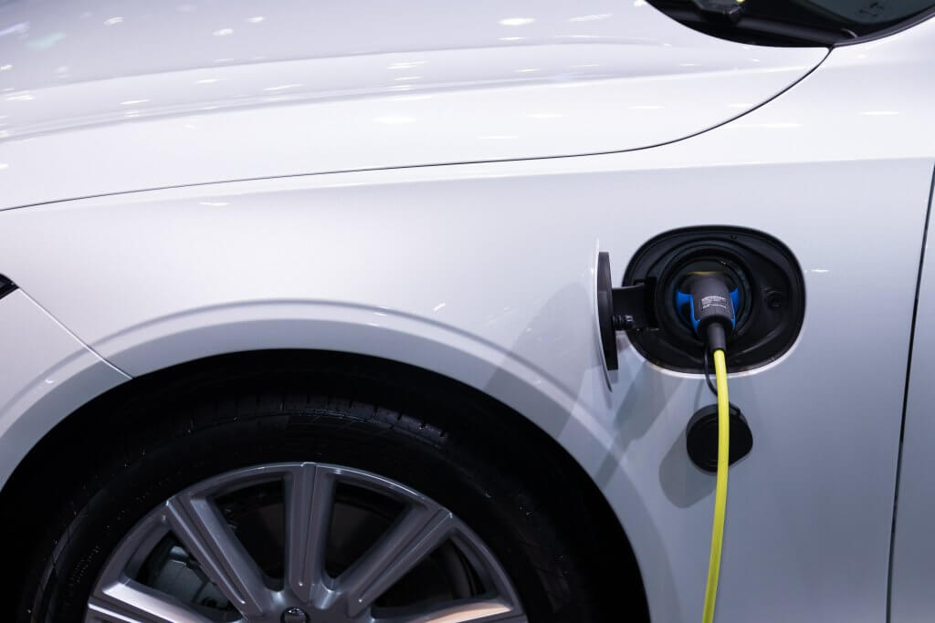 an electric car with charging plug attached