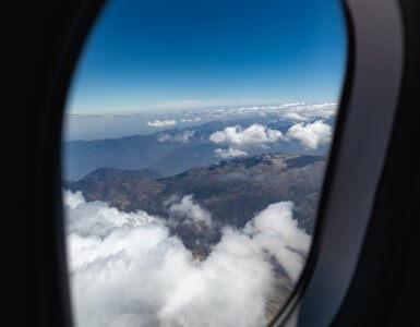 plane in flight showing window view